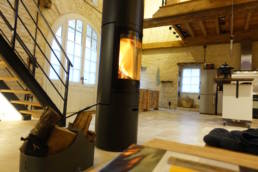 15th century barn conversion w view from living area below the bedroom loft