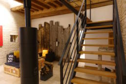 15th century barn conversion living area and stair to upper bedroom lofts