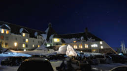 Historic Timberline Lodge Winter Entrance, an illuminated alpine beacon.