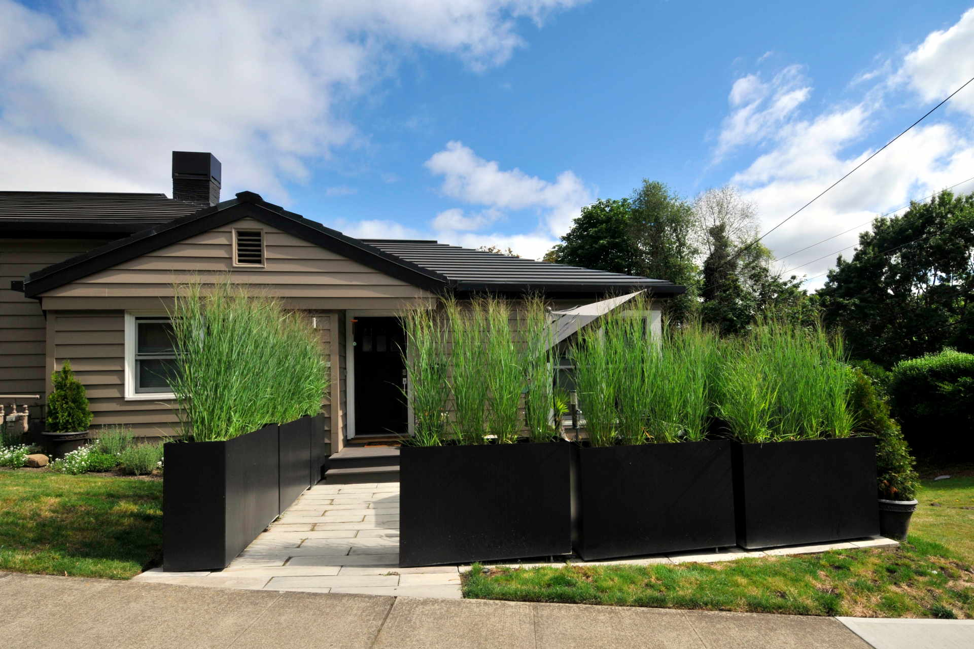 Big Metal Planters powder coated steel can define an outdoor space
