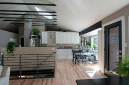 Mid-Century ranch renovation designed and engineered by rhiza A+D view of stair and kitchen